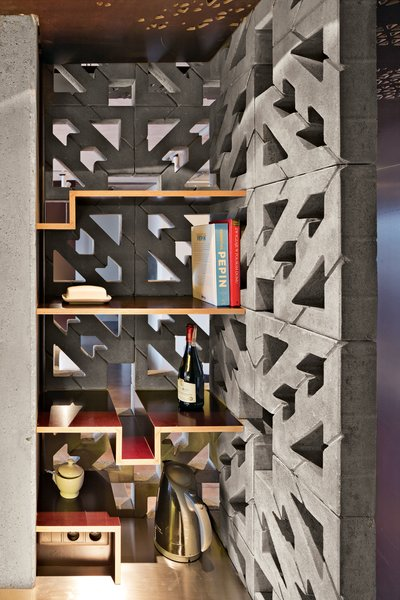 Nix and Novak-Zemplinski designed the black-steel bookshelves and had them fabricated at a local metal shop.