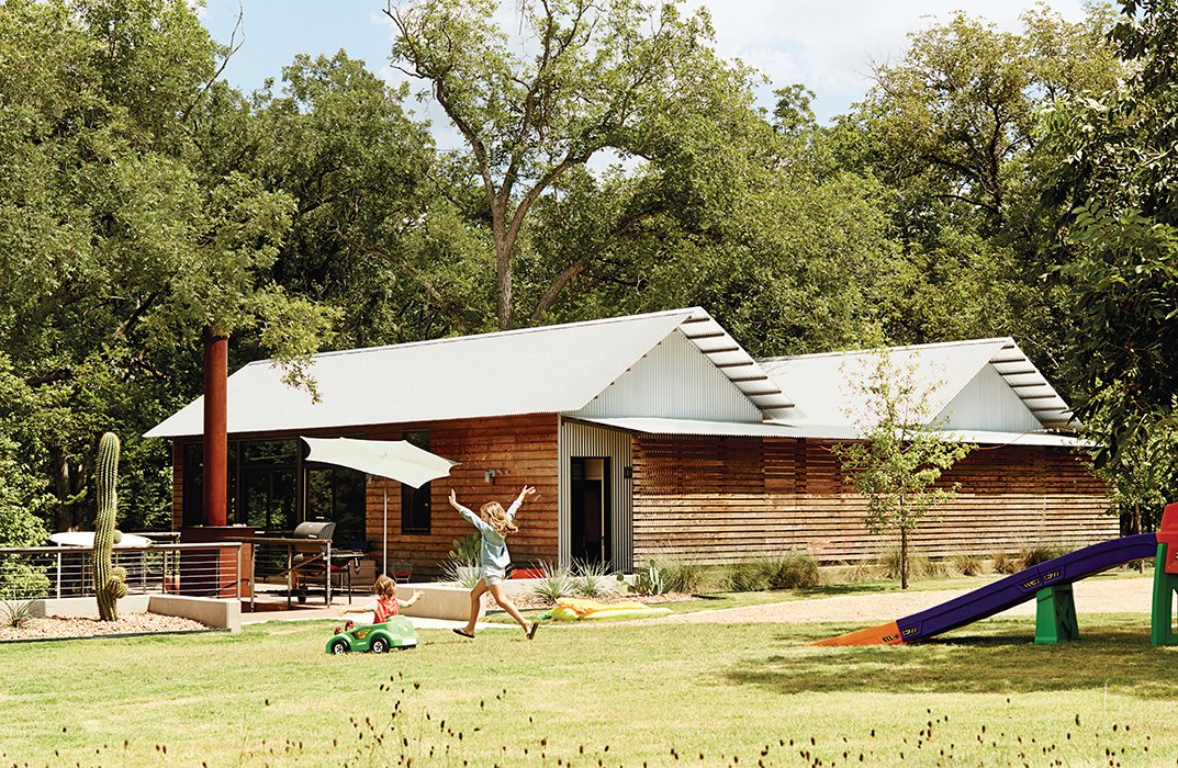 Scott Wallace and Tara Coco turned to Lake|Flato Architects and its modular Porch House system for a family compound on the banks of the Blanco River in Wimberley, Texas. The design integrates private spaces with public gathering spots, including a deck that serves as an outdoor living room.  Superb Single-Story Homes by Luke Hopping from Modular Compound is the Ultimate Retreat for Three Generations