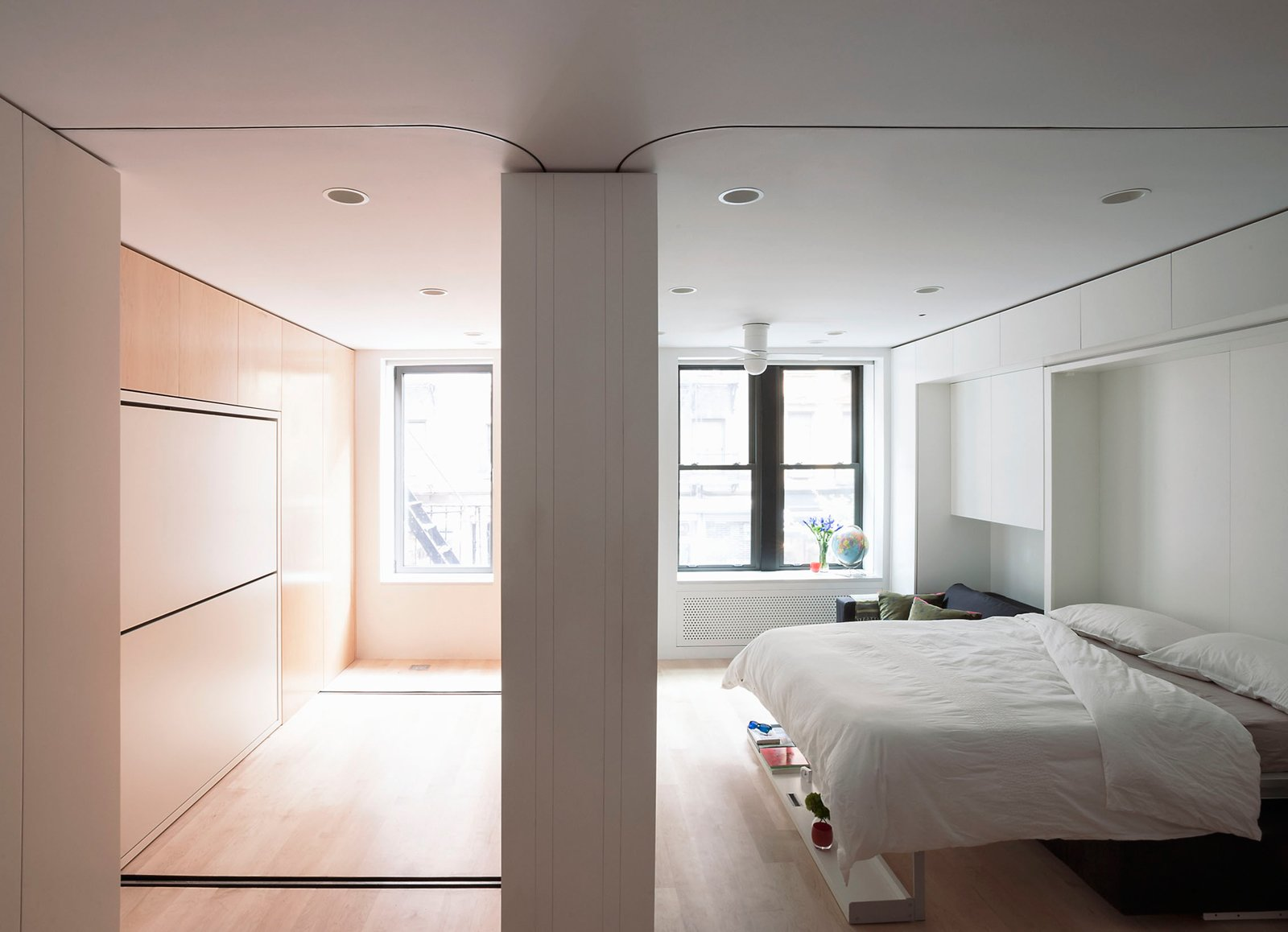 The moving wall opens up a second room, which features bike storage, a second office space, and can be converted to the guest bedroom.