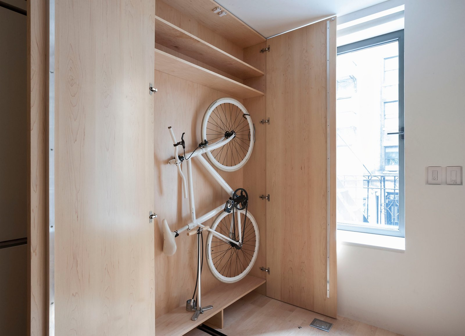 Hill's ThinBike, which he designed in partnership with Schindelhauer, features folding handlebars and pedals that allow it to easily fit snugly against a wall (or in this custom-sized cabinet).