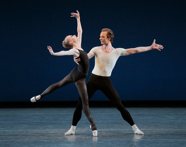 Janie Taylor and Ask la Cour in George Balanchine's Stravinsky Violin Concerto. Designers Will Kavesh and Emrys Berkower of Token mimicked dancers' legs for the steel legs of their tables. Photo by Paul Kolnik.