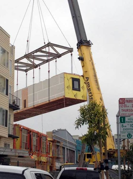 Each day four 65-foot modules were craned into place. Three modules contained a total of six units units; the fourth module contained a four-story stair atrium/elevator. This stacked up to one floor per day.