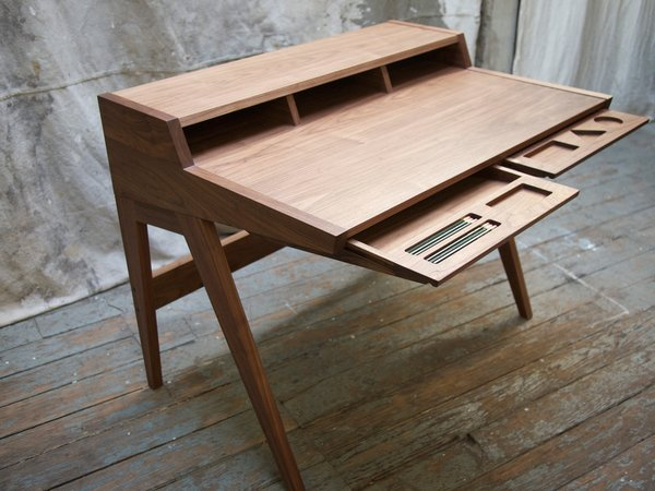 """But…I'm a woodworker, and the Swag desk is made from plastic, laminate, steel, and veneered particleboard or plywood. Those are not my materials of choice. The Swag desk references many Shaker writing desks with their small footprints and its use of cubbies in the back of the desk to organize paper, books, and writing supplies."""