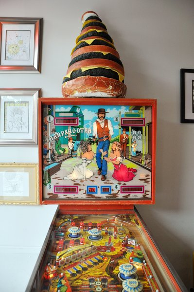 While the food is certainly a draw, so is the eclectic décor, which includes vintage signs, pinball machines, and a fully decorated back patio.