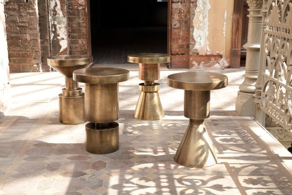 These brass-plated, cold-rolled, hollow-steel chess stools are multi-functional, serving as stool or table. Their geometric shape offers a versatile look appropriate for a variety of styles. Photo by Don Freeman.