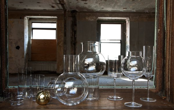 From the hand-blown tumbler set to the decanter with brass stopper, this whole set would outfit any bar cart in style. Photo by Don Freeman.