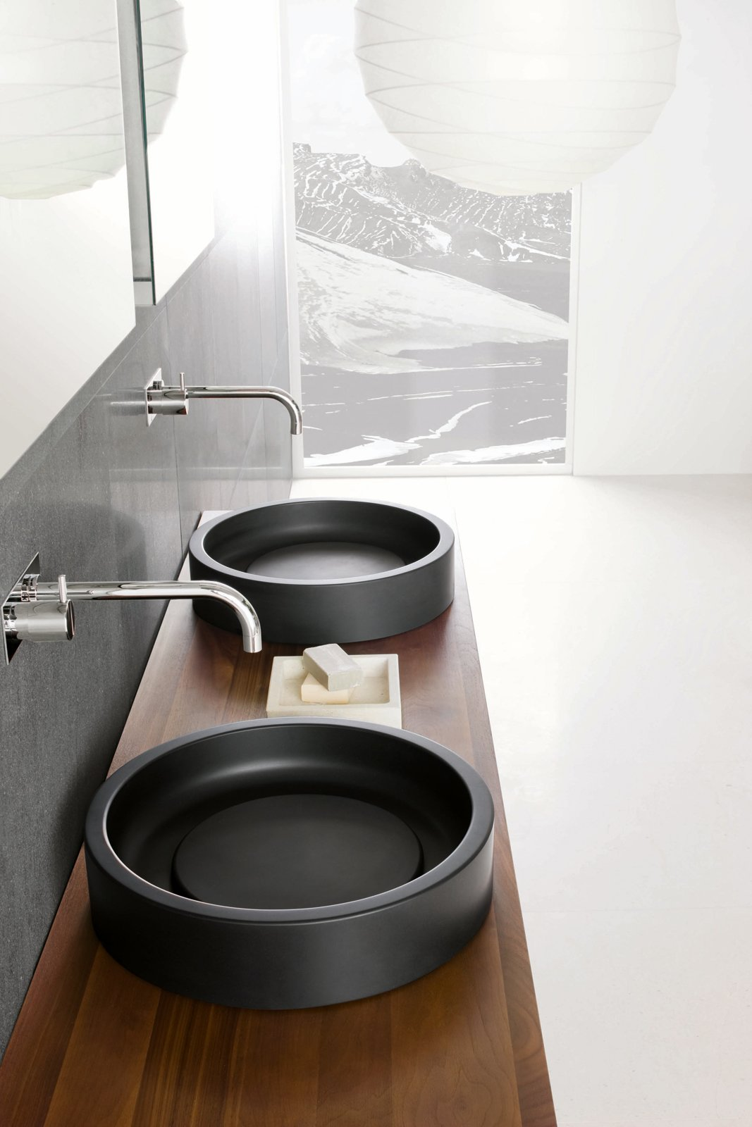 Detail shot of the Inkstone wash-basins in Black Rock stone. Tagged: Bath Room, Wood Counter, and Vessel Sink.  Best Photos from Inky Inspiration