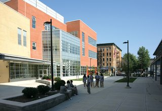 "The urban space is an inspiration for how buildings can facilitate interaction. One example is the Frank R. Conwell School Campus in Jersey City, New Jersey, by Gruzen Samton and IBI Group. ""Over and over you see that the connection to the street is important, whether it's a collection of buildings or a single building it's conceived of in an urban way,"" Mellins says. ""This open area becomes like a main street that you can look across and see what's happening."" This allows for both easy planning of events and chance encounters. Photo by James D'Addio."" /dwell-photo photoId=""6133532723861237760"" caption=""REED Academy in Oakland, New Jersey, is a school for children with autism spectrum disorders. Though it is located in a suburban office park, it, too, utilizes the best parts of city life to enhance learning in terms of socialization and positive interaction within the broader society. ""It was clear that the idea of the street encounter still resonates even if it's in a suburban environment,"" Claire Weisz, principle of WXY Architecture explains. ""Somehow human beings still think as if they are in villages."" Photo by Paul Warchol."" /dwell-photo photoId=""6133532725501210624"" caption=""One unique aspect of REED Academy is that rather than having large hallways with monotonous rows of doors one walks through the school along street-like paths that include a series of alcoves. ""The idea is that as you pass through the hallway it becomes a different space,"" Weisz says. This helps students at REED slowly become comfortable with moving through a building and with interacting socially. ""It could be that a student does a store for a day, or someone puts something special there. We had to do something that didn't give too many clues, because part of it is teaching the kids the grid of a building,"" Weisz further explains. ""It's a place where everyone feels safe and accepted, but also they can learn to cope with more stimulus. It's this thing where the building is used to build capacity. It made me think: This is not so different than you and I."" Photo ©Albert Vecerka/Esto."" /dwell-photo photoId=""6133532727434895360"" caption=""The bowstrings of several arches extend beyond the central space, providing ample amounts of natural light. ""The central space is a kind of town square,"" Mellins says. ""And what you learn in a town square, or can learn and observe, is how people interact."""" /dwell-photo photoId=""6133532728722546688"" caption=""Many of the schools represented in Edgeless are for students requiring different methods of education, from an emphasis on the arts or teaching those with special needs. The possibilities of learning in new or different ways creates opportunities for new spaces to assist in that learning. <br><br>""All of a sudden your teacher isn't teaching a classroom of kids. The classroom is just a place that the teacher and student go to periodically during the day when they need to be there,"" Weisz explains. ""This is a school that's designed around a way to teach, not a school that was designed because they needed a place to house people."" Photo ©Albert Vecerka/Esto."" /dwell-photo photoId=""6133532731423567872"" caption=""Part of the concept of Edgeless-ness includes exploring the outside and nature within a city, further expanding what a classroom can be. At the Rogers Marvel designed Stephen Gaynor School in New York, students take advantage of green spaces. Photo ©David Sundberg/Esto."" /dwell-photo photoId=""6133532734238056448"" caption=""St. Albans School in Washington, DC, by Skidmore, Owings & Merrill is located on a beautiful campus in the shadow of the Olmsted-designed National Cathedral. Facing the challenge of fitting in within this existing, historic space, the architects create paths on the roof and underneath the buildings that ""allow for a meandering through the campus"" in order to ""take on a quality of a pilgrimage in the shadow of the Cathedral,"" Mellins says. Photo ©Robert Polidori."" /dwell-photo photoId=""6133532736536424448"" caption=""Part of being Edgeless is in the way a school fits within a community, especially in an urban environment. The Frank Sinatra School of the Arts in Queens, New York, thrives in a bustling area of Astoria. ""The school gets so much out of being in that lively neighborhood, and that neighborhood gets more lively because of the presence of the school. There's a symbiosis,"" Mellins says. ""The most dramatic translation of edgeless-ness is literal transparency. You can see the ballet students at the bar from the street."" School designed by Ennead Architects. Photo by ©Aislinn Weidele/Ennead Architects."