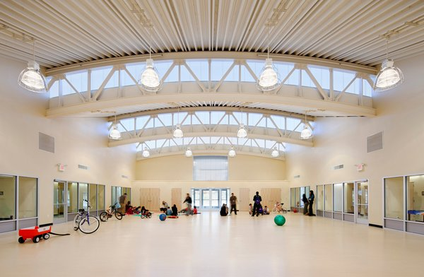 "The bowstrings of several arches extend beyond the central space, providing ample amounts of natural light. ""The central space is a kind of town square,"" Mellins says. ""And what you learn in a town square, or can learn and observe, is how people interact."""