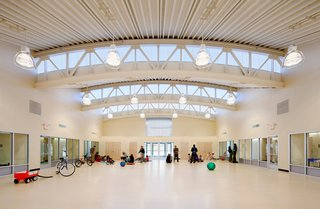"""The bowstrings of several arches extend beyond the central space, providing ample amounts of natural light. """"The central space is a kind of town square,"""" Mellins says. """"And what you learn in a town square, or can learn and observe, is how people interact."""""""