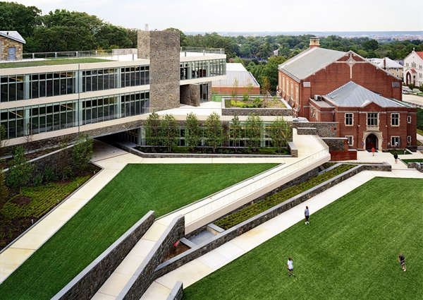 "St. Albans School in Washington, DC, by Skidmore, Owings & Merrill is located on a beautiful campus in the shadow of the Olmsted-designed National Cathedral. Facing the challenge of fitting in within this existing, historic space, the architects create paths on the roof and underneath the buildings that ""allow for a meandering through the campus"" in order to ""take on a quality of a pilgrimage in the shadow of the Cathedral,"" Mellins says. Photo ©Robert Polidori."