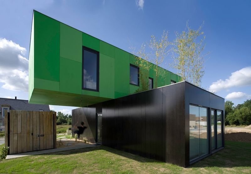 CG Architectes stacks two containers perpendicularly for this Brittany, France, house.  Shipping Containers by Dwell from Amazing Examples of Shipping Container Architecture
