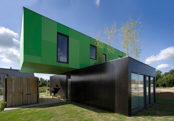 CG Architectes stacked two containers perpendicularly for this house in Brittany, France.