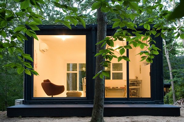 Maziar Behrooz designed this container studio set amid lush trees.  Shipping Containers by Dwell from Amazing Examples of Shipping Container Architecture