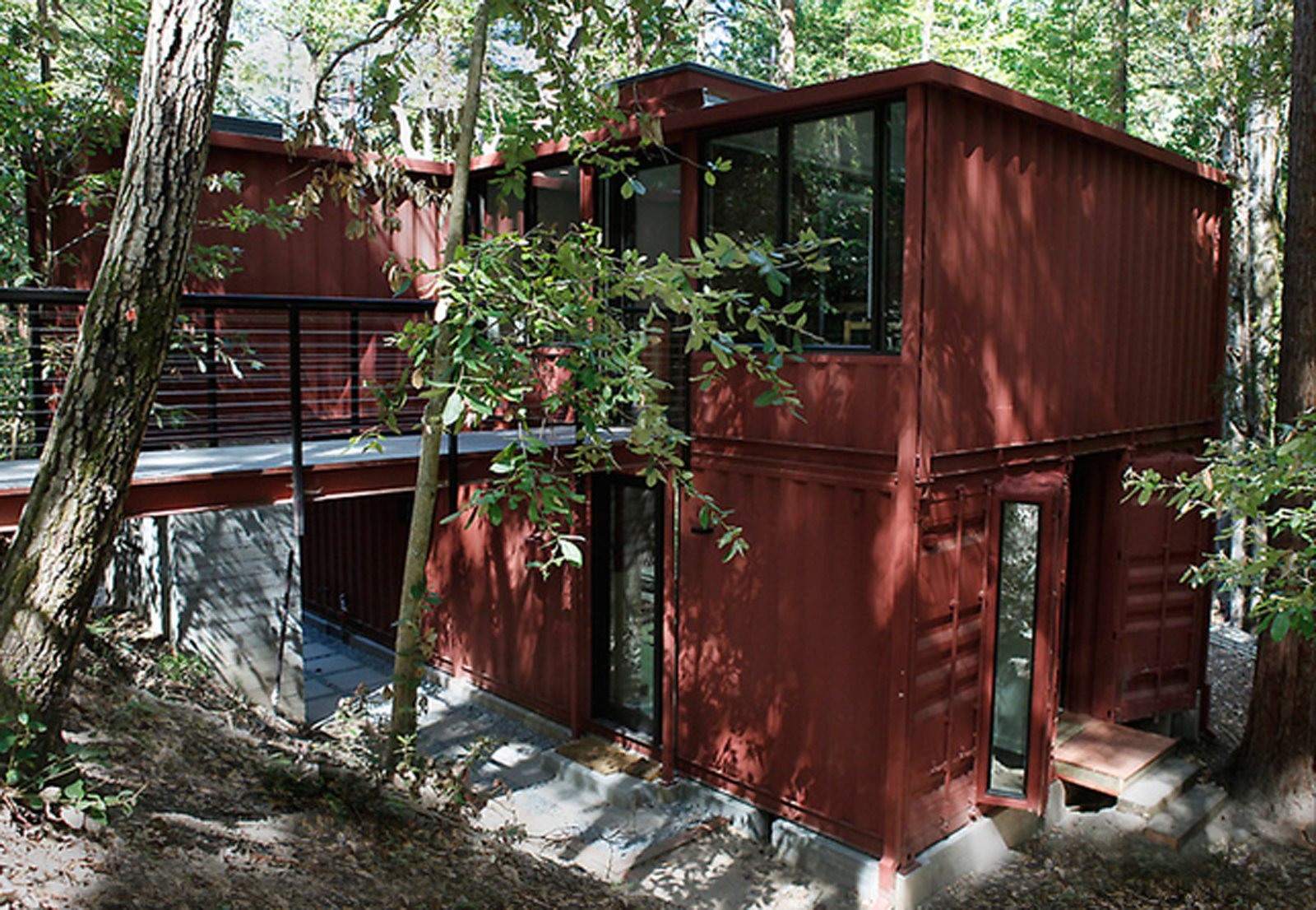 Shipping containers are the building blocks of this residence tucked away in the redwood forests of Santa Cruz, California.  Shipping Containers by Dwell from Amazing Examples of Shipping Container Architecture