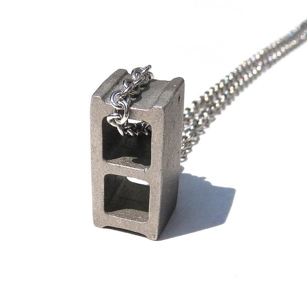 For the builder in you, sport this hip cinderblock necklace by Max Steiner. ($65)
