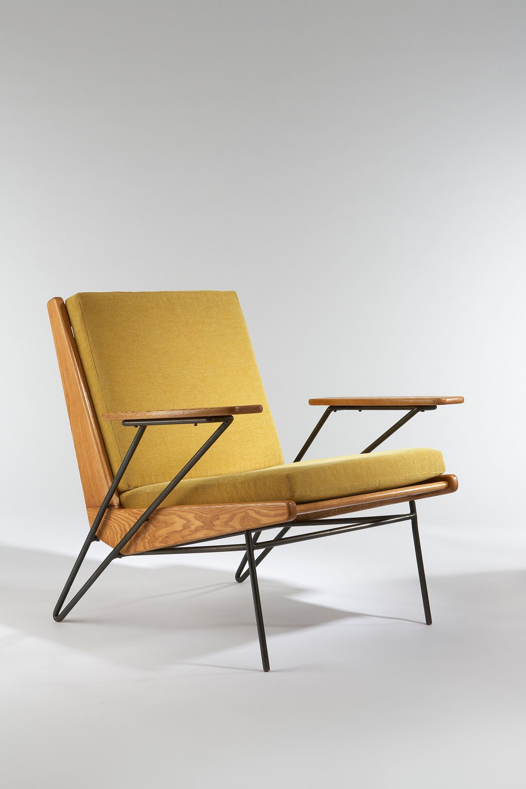 Armchair, 1953. Ash, black enameled metal, upholstered. By Pierre Guariche.  Photo 3 of 3 in 3 Tips for Mid-Century Modern Collectors