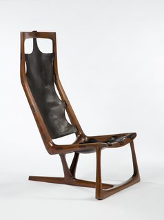 "Early ""Kangaroo"" Chair, 1962. Walnut and leather. By Wendell Castle."