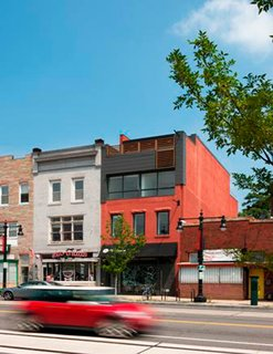 "Design Army was one of the first businesses to arrive on H Street in DC--an emerging neighborhood in the northeast quadrant of the city. ""For me, when we were thinking about workspace, I wanted to own our building. So we own this building. We added two floors—one floor and a floor with a kitchen with a roof deck. I didn't want to have a landlord or pay rent. I wanted full control of everything. We bought it as a burnt-out shell. It was a pool hall. The last time it was occupied was during the 1968 riots,"" says Jake. Photo by: Anice Hoachlander of Hoachlander Davis Photography"