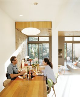What Would Eichler Do? - Photo 2 of 8 - Krubiner (here, with girlfriend Kylie Gordon) furnished the house with finds from Craigslist and eBay, such as the 1970s Milo Baughman dining table and Norman Cherner chairs.