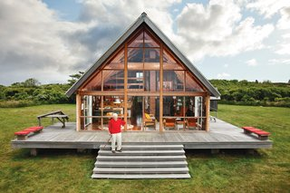 Mid-century designer Jens Risom's A-framed prefab family retreat, located on the northern portion of Block island, is bordered by a low stone wall, an aesthetic element that appears throughout the land.