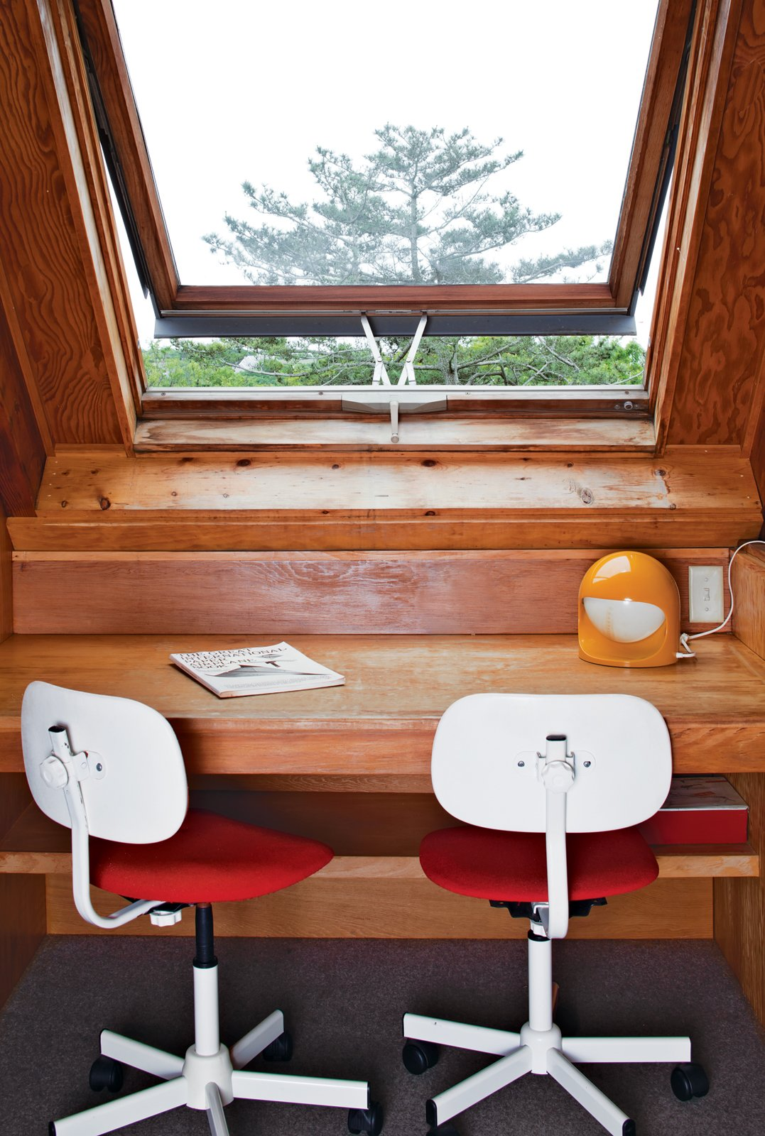 There is a small workstation on the upper level of the house.