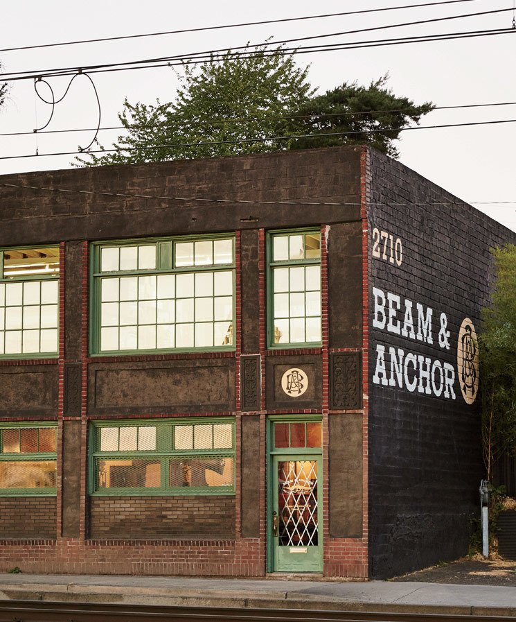Train tracks run adjacent to Beam & Anchor, adding to its romantic charm. Tagged: Exterior, Brick Siding Material, and Flat RoofLine.  Modern Spaces in the Pacific Northwest by William Lamb from A Portland Store That Hosts Workshops for Local Craftsmen and Makers