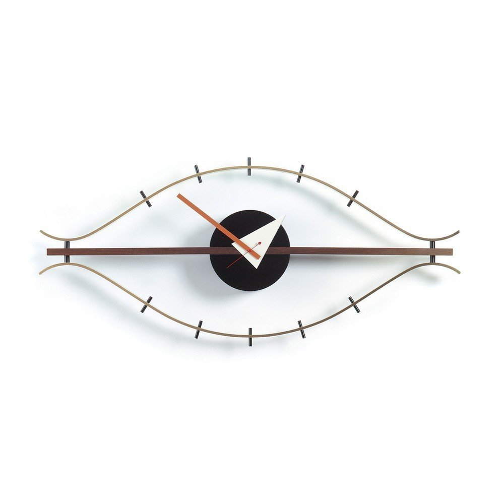 George Nelson worked with Vitra to create a variety of wall clocks, including the Eye Clock, rendered here in luxe brass and rich walnut. Now considered an icon of midcentury design, the Eye Clock is a distinct departure from traditional clocks—it is shaped like an abstract eye, including lash ticks to mark the time instead of a conventionally numbered face.  Modern Wall Clocks by Marianne Colahan