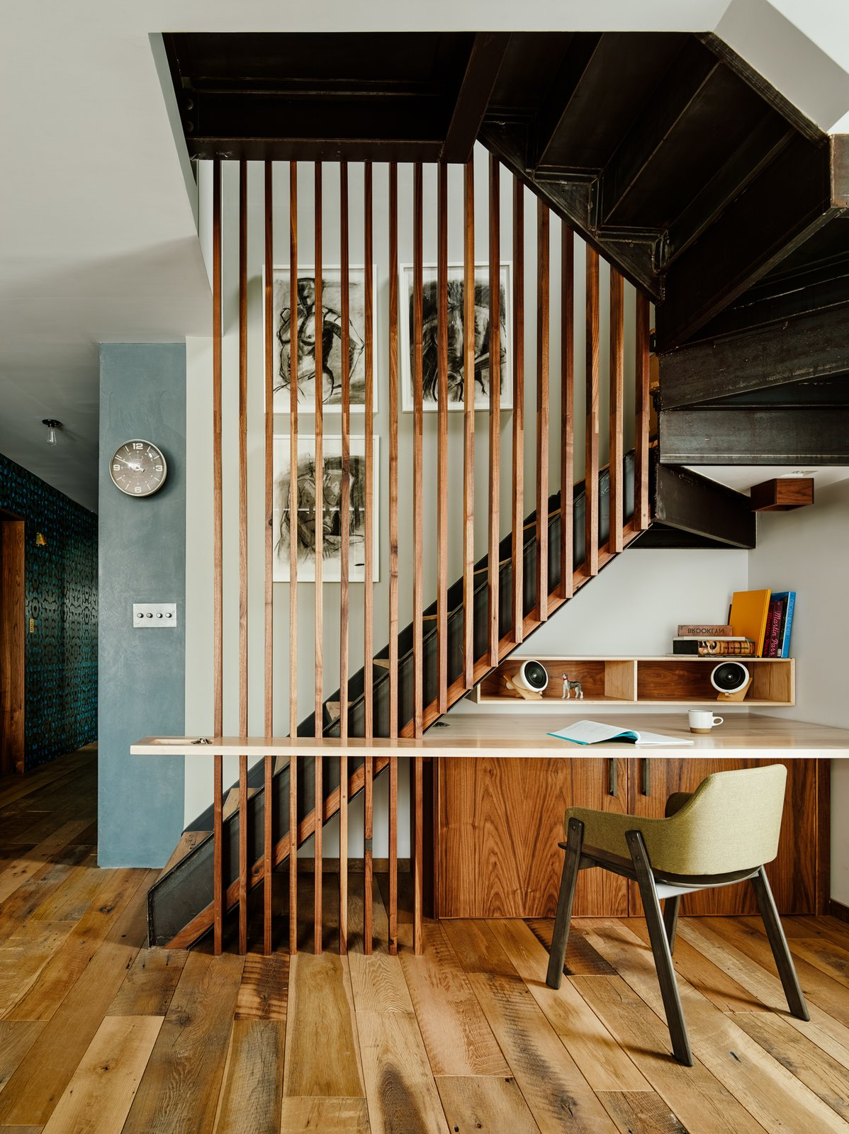 Zames carved out a small custom office area under the stairs that lead up to the roof. Home Offices and Workspaces We Love by Matthew Keeshin