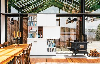"""Renovated Garage is the Ultimate Modern Party Space - Photo 2 of 9 - The """"tiny but mighty"""" structure—as Grizzle describes it—packs a wealth of uses into a compact footprint."""