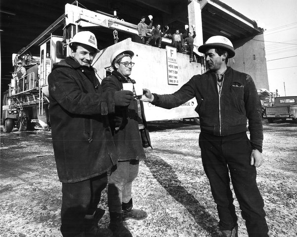 Builders toast the casting completion of the last box at Habitat '67 in Montreal, Quebec.