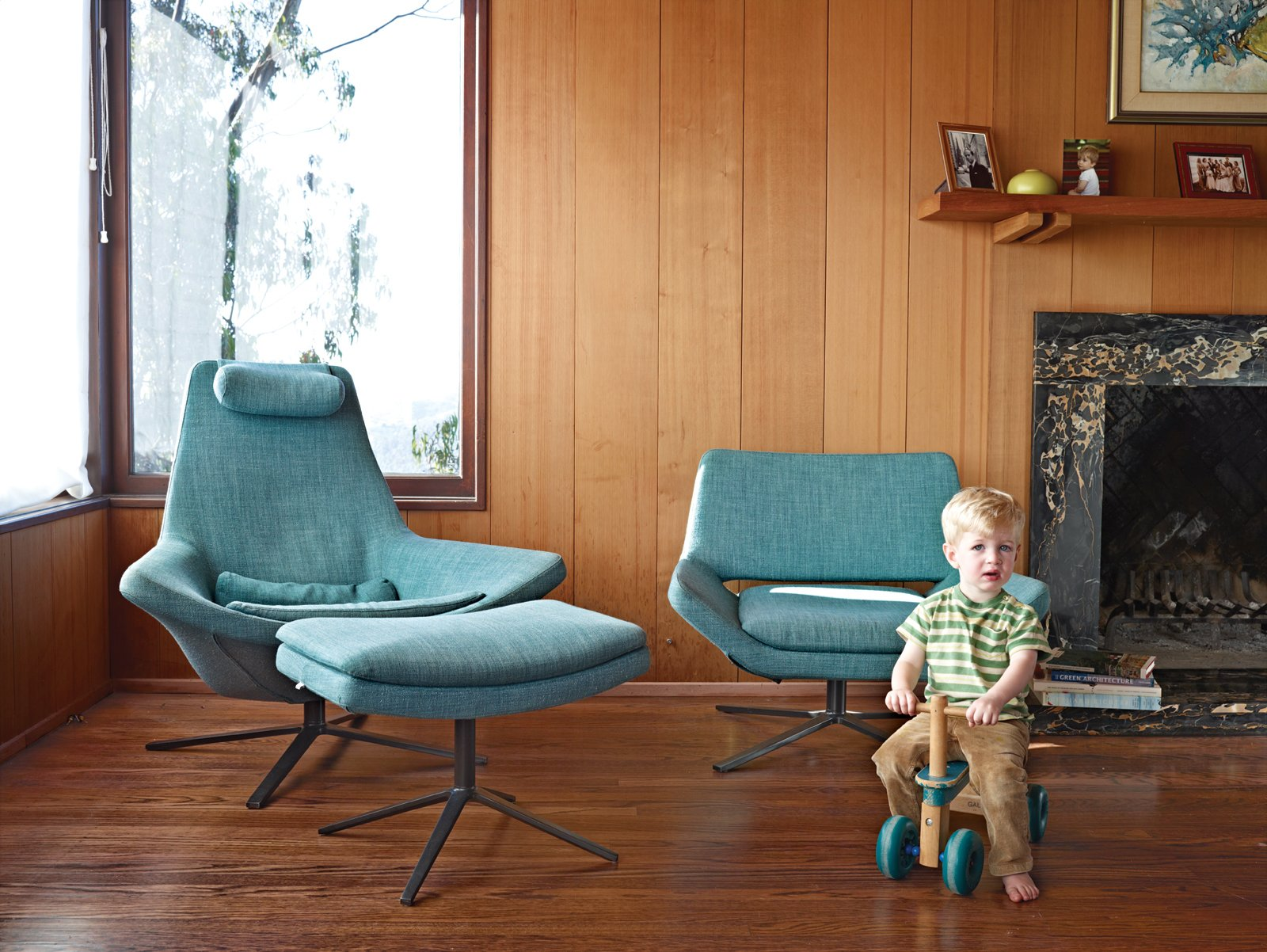 Paul cruises by Metropolitan pieces by B&B Italia in the living room of the main house.  Midcentury Homes by Dwell from A Modern Prefab Addition to a Mid-Century California Classic
