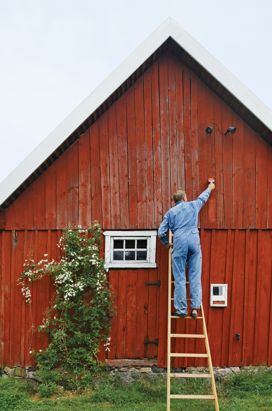 The exterior paint, Falu Rödfärg, is made locally in Falun, Sweden. It requires no primer or sealant  due to its highly pigmented, all-natural composition. Using it eliminated some supply costs associated with outdoor painting.  Photo 6 of 12 in Modern Meets Traditional in a Swedish Summer House