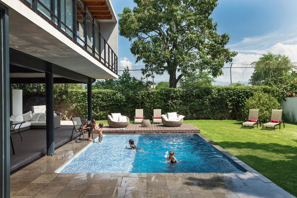 The house is oriented toward the expansive backyard, where the family spends 80 percent of its time. Alfredo's wife Lorena, son Lorenzo, nieces Camila and Valentina, and Castillo's daughter, Regina, hang out by the pool—the focal point of Transepto's restrained landscape design.