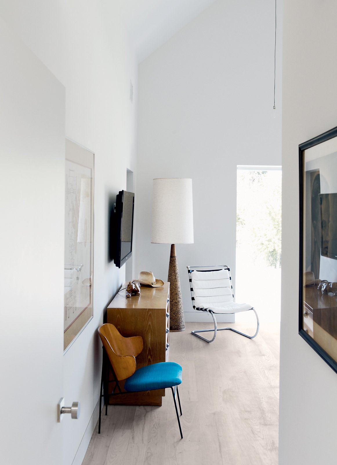 The dresser at the other end of the bedroom is by Paul Frankl; the plywood lounge chair is by Ib Kofod-Larsen; and the huge cork-based floor lamp is from Reeves Antiques.  Photo 5 of 15 in Row on 25th: Affordable Housing Development in Houston