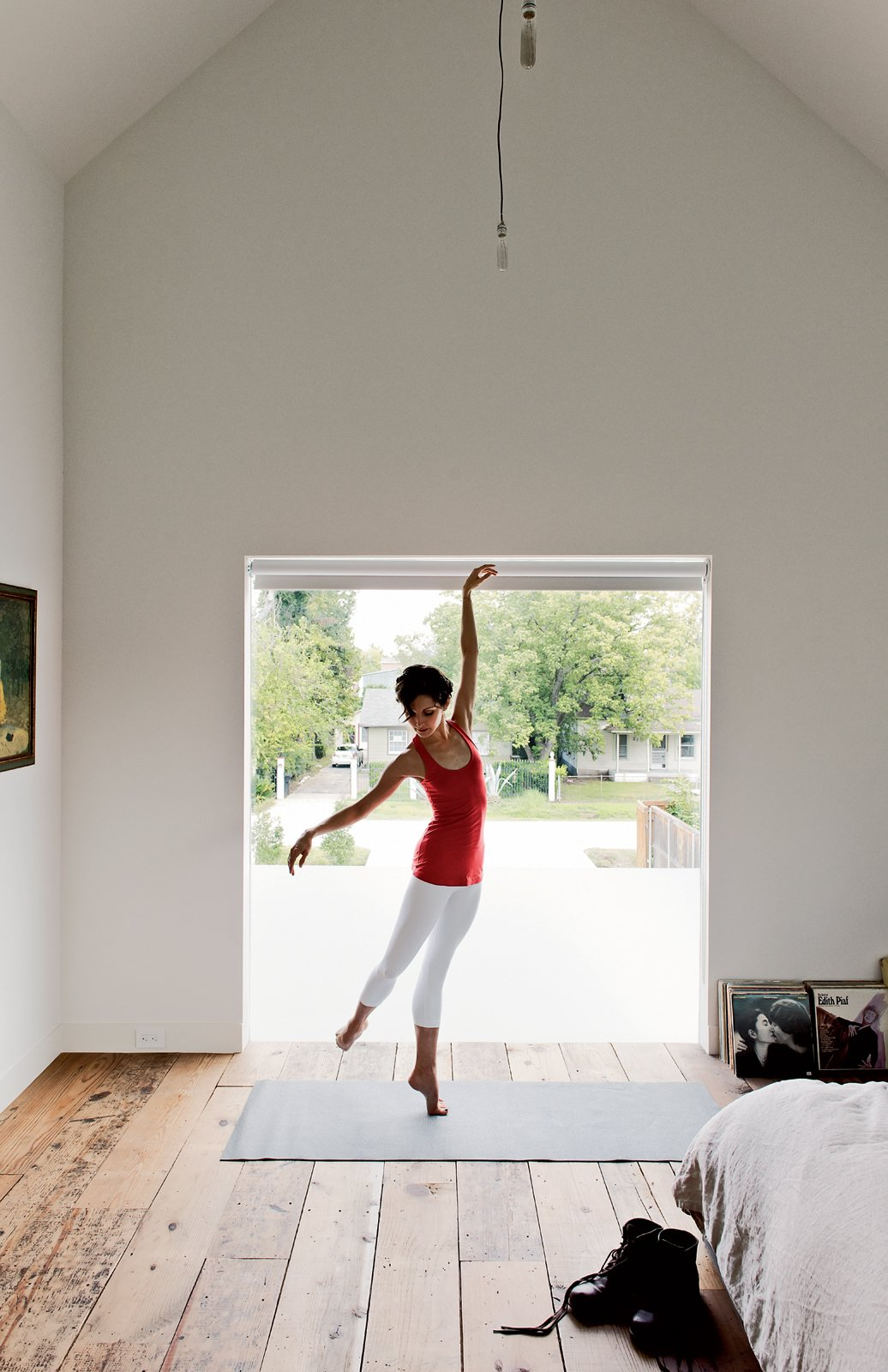 Lauren Strongin dances in front of the custom window designed by Shade House Development. Tagged: Bedroom and Medium Hardwood Floor.  Photo 12 of 15 in Row on 25th: Affordable Housing Development in Houston