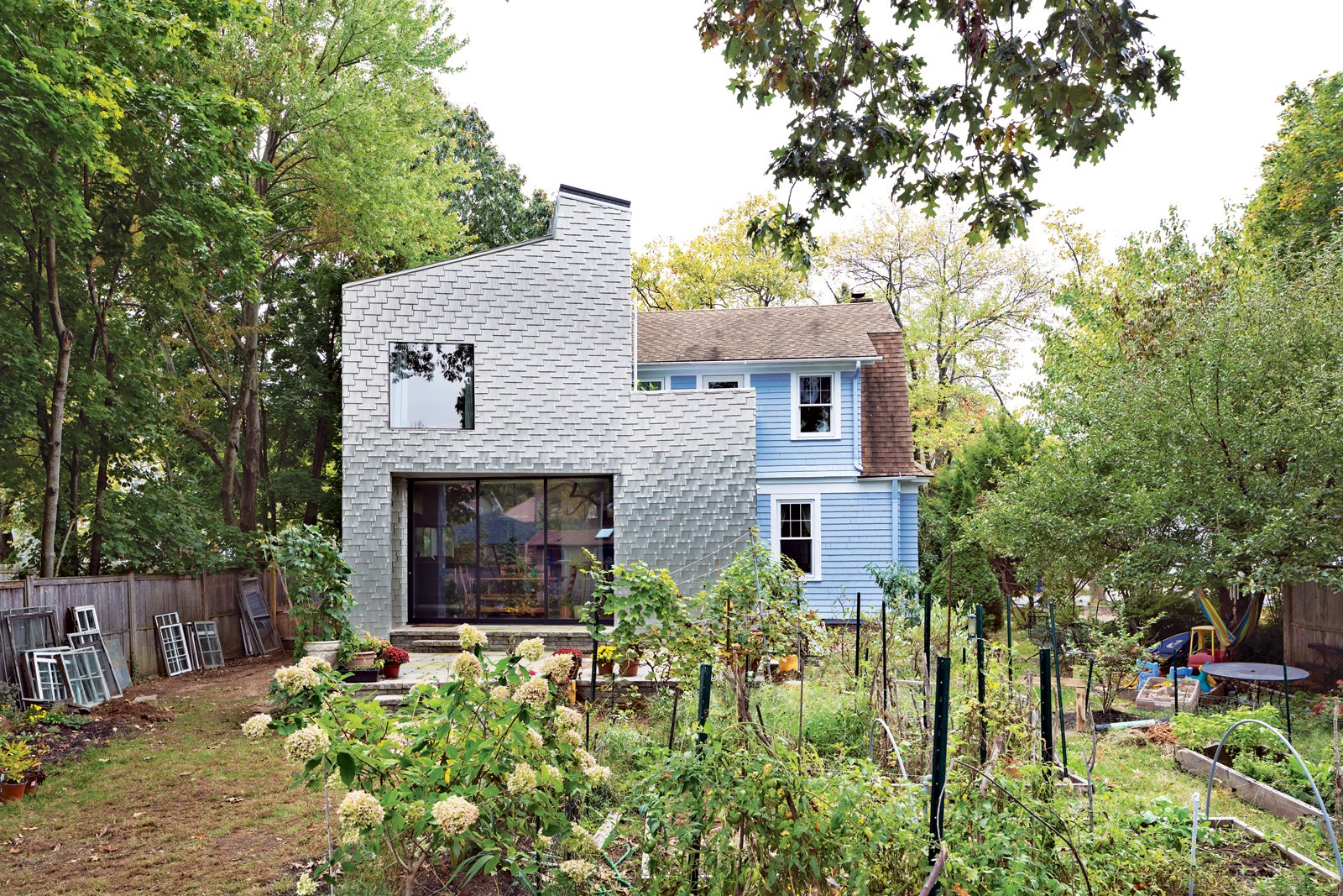 A Traditional Shingle-Clad Home in Connecticut  The metal shingles that cover the addition of this Connecticut home are on the cutting edge of modern design.  Photo by: Andrew Rowat