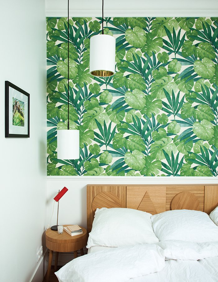 The headboard in Hansen's bedroom echoes the 2013 side-board. The wallpaper is from Arte. Tagged: Bedroom, Pendant Lighting, Bed, and Night Stands.  Photo 18 of 42 in Wallpaper That Fixes Walls