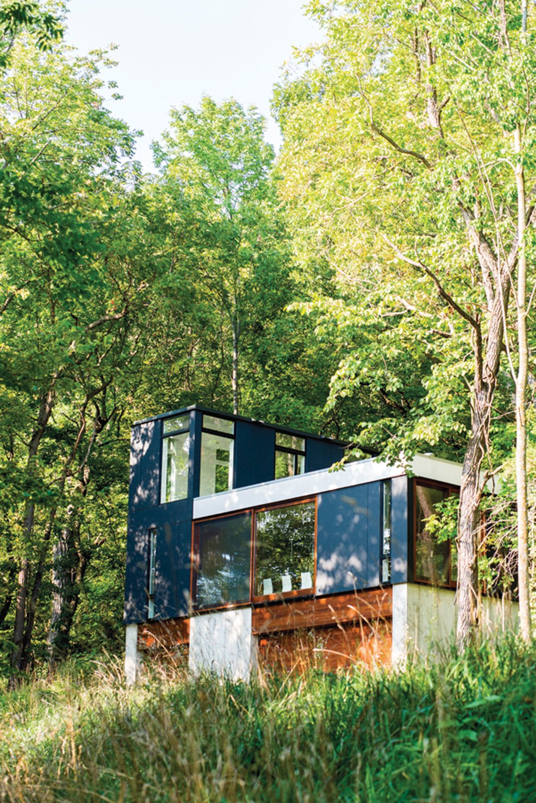 Short StackA tiny cabin in the Wisconsin Woods makes a big impact with Johnsen & Schmaling's innovative stacked design. The resulting cozy abode is stylish and durable, with stunning views of the surrounding landscape. Tagged: Exterior, Cabin Building Type, and Metal Siding Material.  Photo 15 of 101 in 101 Best Modern Cabins from Preview the February 'Modern for Less' Issue