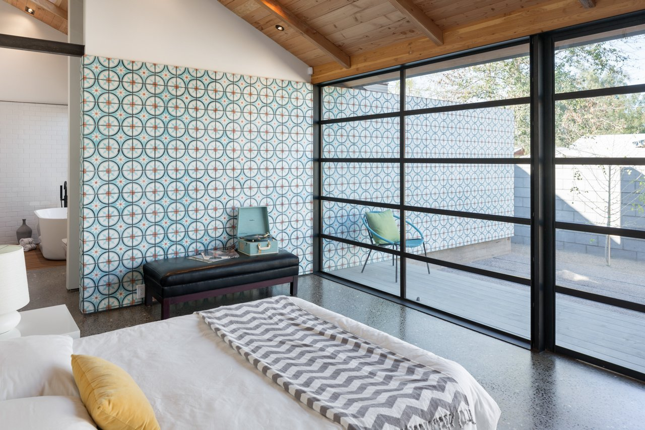 With the house often open to the outside, dust easily drifts in. Fortunately, the concrete floor, speckled with white aggregate mix, is easy to clean. Tagged: Bedroom and Bed.  Bedrooms by Dwell from Amazing House is Half Historic and Half Modern