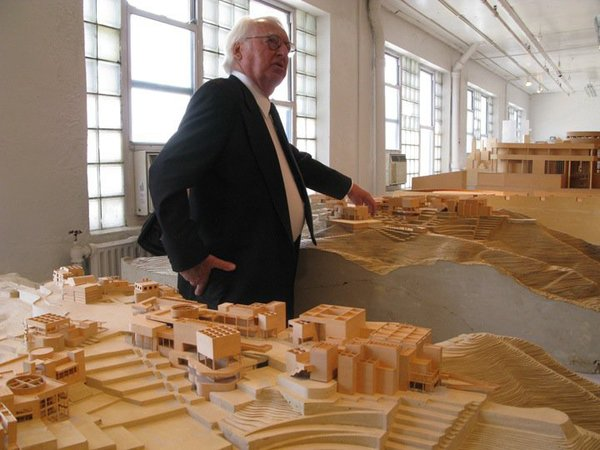 "Richard Meier on a tour of his firm's model museum in Long Island City, 2010. (Photo: Kelsey Keith)<br><br>Addressing the common practice of architectural competitions, Meier explains, ""Sometimes if you do a competition, you know you're taking a risk of it not happening. Many of them that we've done remain unbuilt for us, and unbuilt for anyone. We always look at competitions very carefully to try and determine whether it's just emotion on the part of the sponsors or it's something real."