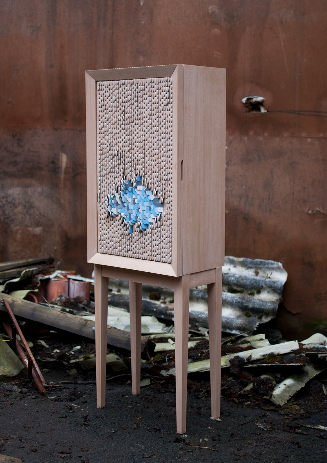 Dear disaster by Swedish designer Jenny Ekdahl is simply a cupboard with a movable surface structure. Perhaps not so simply, its surface is comprised of 2,000 wooden scales, which can be reversed to create a constant shift of pattern.  Emerging Design Talent at imm Cologne by Amanda Dameron