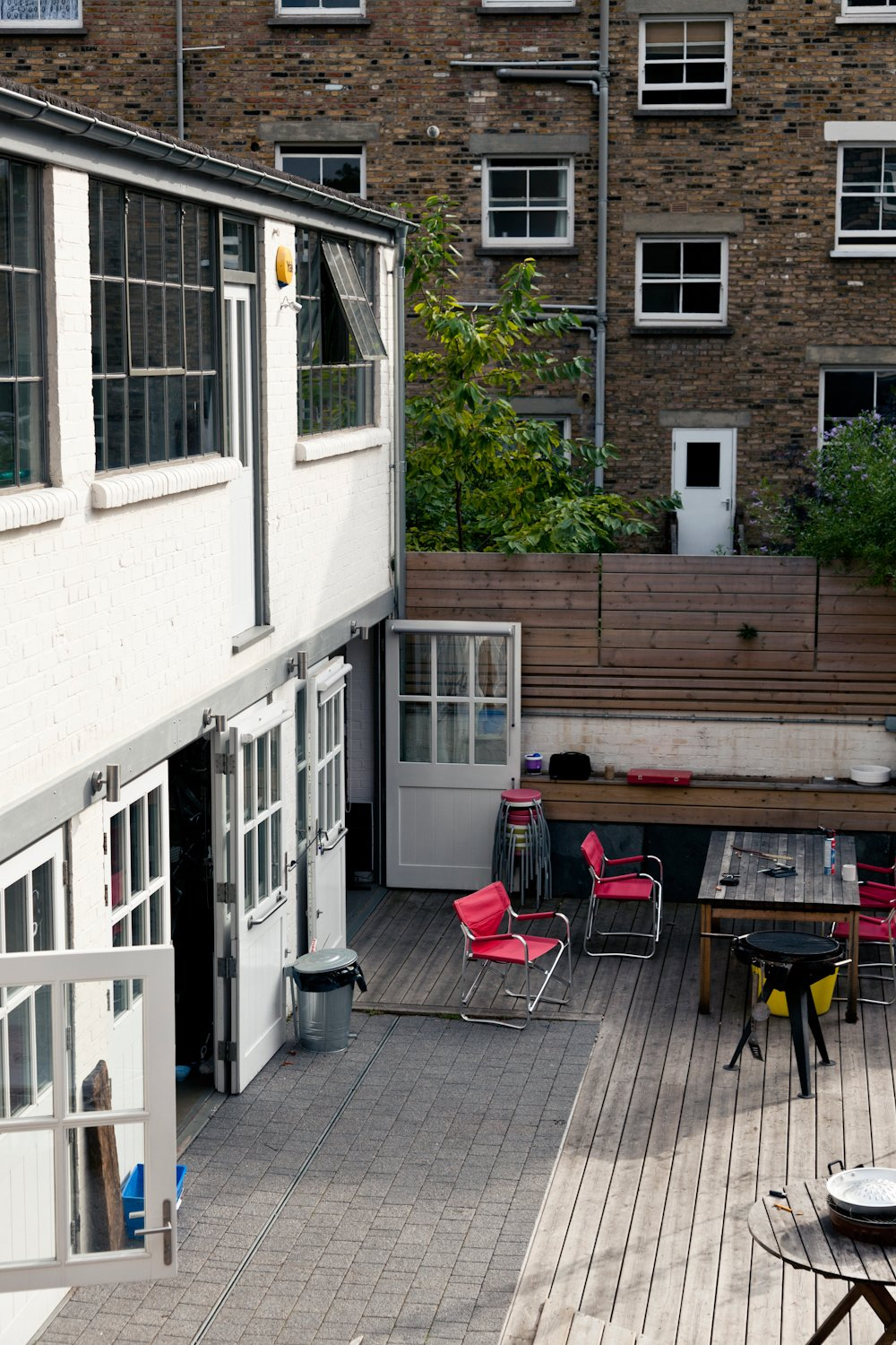 Indoor/outdoor living abounds, with plenty of room for entertaining, especially in the custom courtyard that has held hundreds of guests at many a party.  Photo 6 of 10 in 10 Indoor-Outdoor Homes in London from A Wheelchair-Accessible Adaptive Reuse Project in London