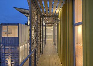 """Who Knew a Relaxing Tropical Retreat Could Be Made of Shipping Containers? - Photo 2 of 10 - Trejos found that working with the containers was like playing with puzzle pieces. By arranging them in stacks of two and sliding the top containers, she created an interior courtyard and gallery space as well as terraces on the upper level. """"Working with containers for the first time was a big challenge,"""" she says, """"but from the first draft on, it was an awesome experience. They already create space, so you just need to play with the puzzle pieces."""""""