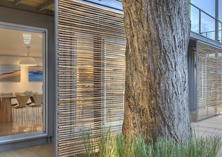 Who Knew a Relaxing Tropical Retreat Could Be Made of Shipping Containers? - Photo 8 of 10 - Sliding bamboo panels on the west side of the house can be adjusted to provide shade during the later part of the day.