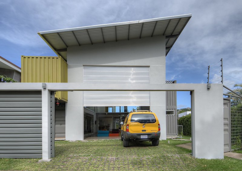 The slanted roof above the garage, painted white to reflect the heat in the tropical environment, also contains a solar heating system for water. The home also features a rainwater collection system, particularly useful during the long rainy season.  Photo 10 of 11 in Who Knew a Relaxing Tropical Retreat Could Be Made of Shipping Containers? from Who Knew a Relaxing Tropical Retreat Could Be Made of Shipping Containers