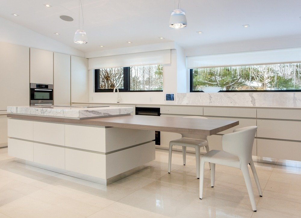 The kitchen features a distinctive cantilevered countertop.