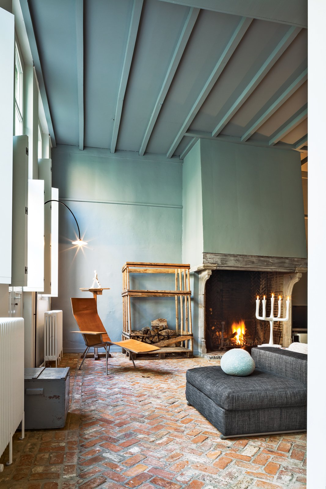 Wenes incorporated artful furnishings into the private spaces: In the living room, a leather chair by Maarten Van Severen is beneath a lamp by his son, Hannes Van Severen, of design duo Muller Van Severen. This House Proves Art Galleries Can Be Super-Friendly - Photo 2 of 19