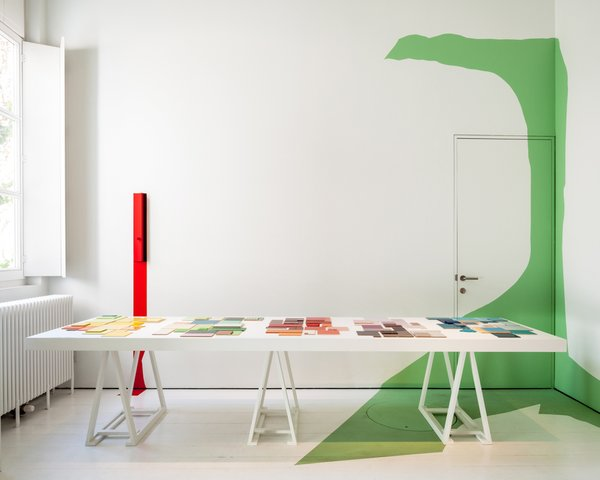 A workspace within Wenes's Antwerp house and gallery features splashes of color.