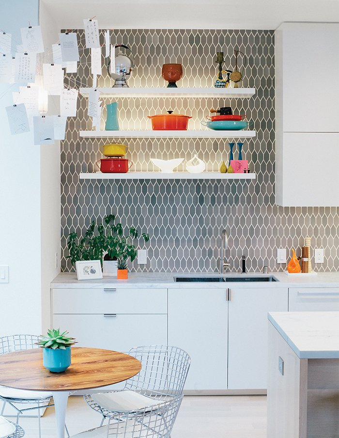 The space is just off the kitchen, which was moved and updated. Bradley paired cabinetry of his own design with tiles from Heath Ceramics. Tagged: Kitchen and White Cabinet.  Photo 2 of 19 in A Home with Eclectic Style Looks Just Right